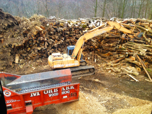 Log Pile Track hoe Pic West Chester, PA - Mulch Works Recycling